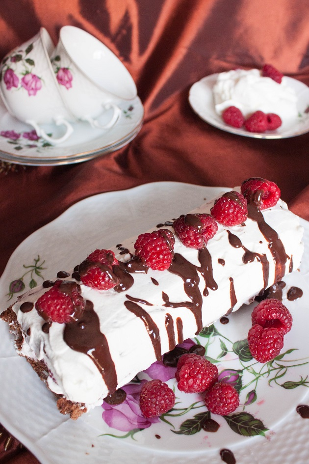 Chocolate Cake Roll with Cream and Raspberries